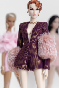 "DESIRED $60.00 Long sleeve V neckline playsuit Material: Poly lurex chiffon Colour: Purple with metallic gold Back closure with hooks and thread loops Fully lined  Model: Colette in NuFace body Fits 12"" Fashion Royalty and Nuface dolls  Note: Fur shawl in mauve pink (wrapped around wrist) is optional for add-on."
