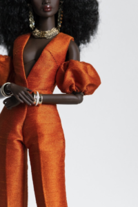 THE GETAWAY $62.00 V neckline jumpsuit with puffed sleeves Material: Shantung Colour: Burnt orange Front closure with hook and thread loops Fully lined  Model: Nadja in Nuface body Fit best on Nuface body  Bag or head wrap is NOT included.